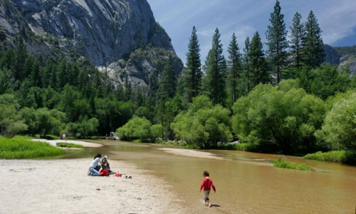 Kid playing in Merced River in Yosemite