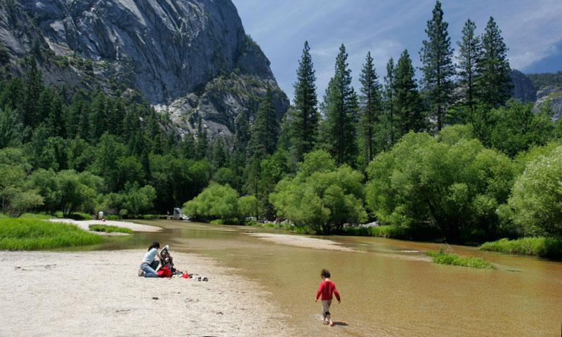 Kid playing in Merced River in Yosemite